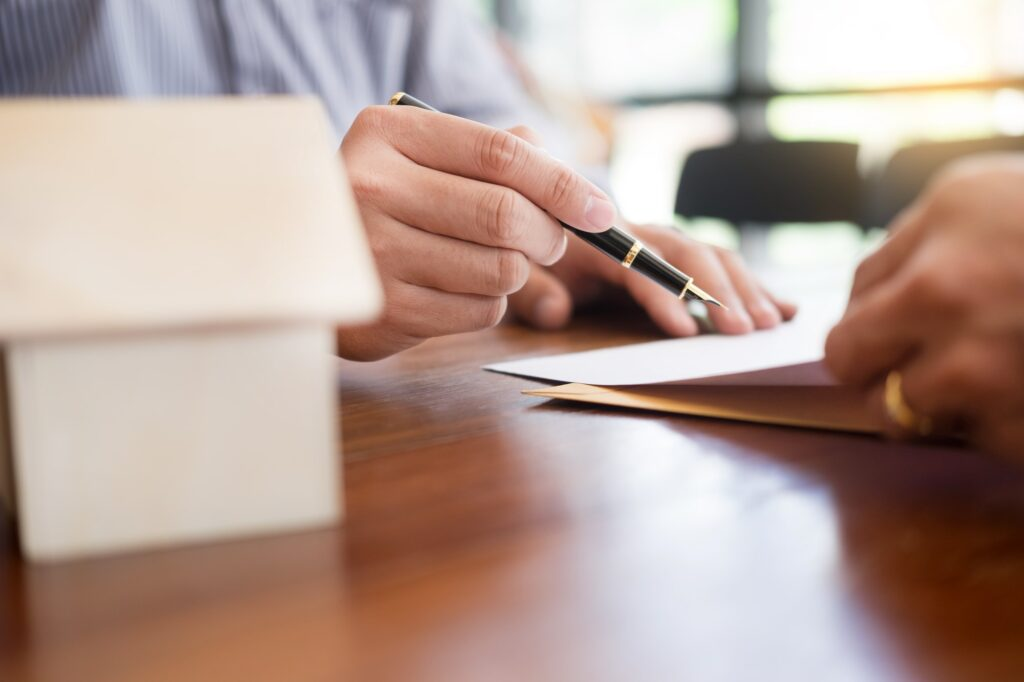 signing a contract to buy a house